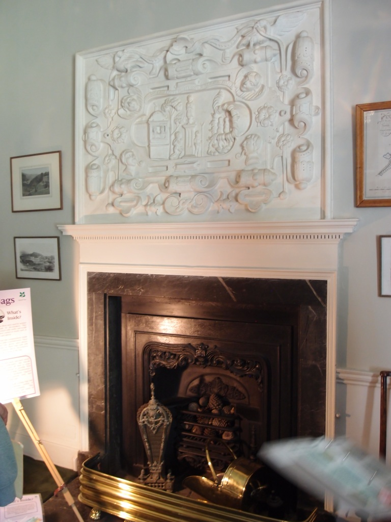 The Winter Dining Room. The plasterwork over mantle depicts the Old Testament story of Daniel's three friends being thrown into the fiery furnace for refusing to worship a golden idol (quite a domestic fireplace decoration eh?). This plaster relief is thought to have been part of the site's original Tudor mansion. How it came to be saved, and then reinstalled in the current House is a mystery.