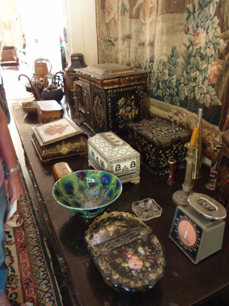 Every flat surface of the Inner Hall is overflowing with the family's collections.