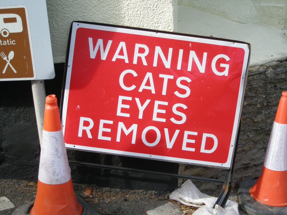 I hopped out of the car and took this picture, just to prove that the removal of man-made Cat's Eyes is a routine event, in the United Kingdom!