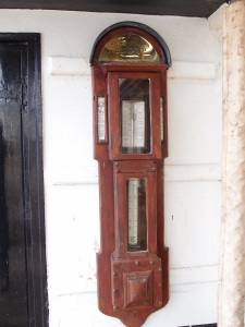 The street at Bayard's Cove (often used for location shots in period films) is lined with attractive 17th to early 19th century homes. Here, a barometer.