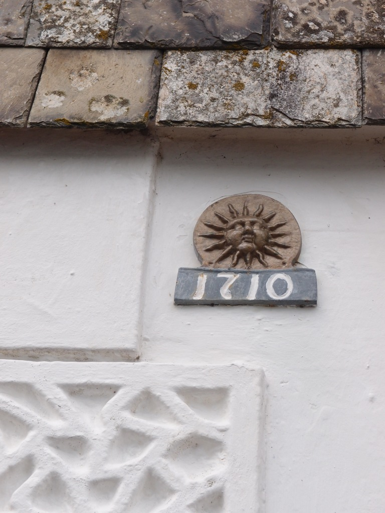 Gull Cottage bears a sunshine medallion, which is a Fire Insurance Mark, circa 1710.