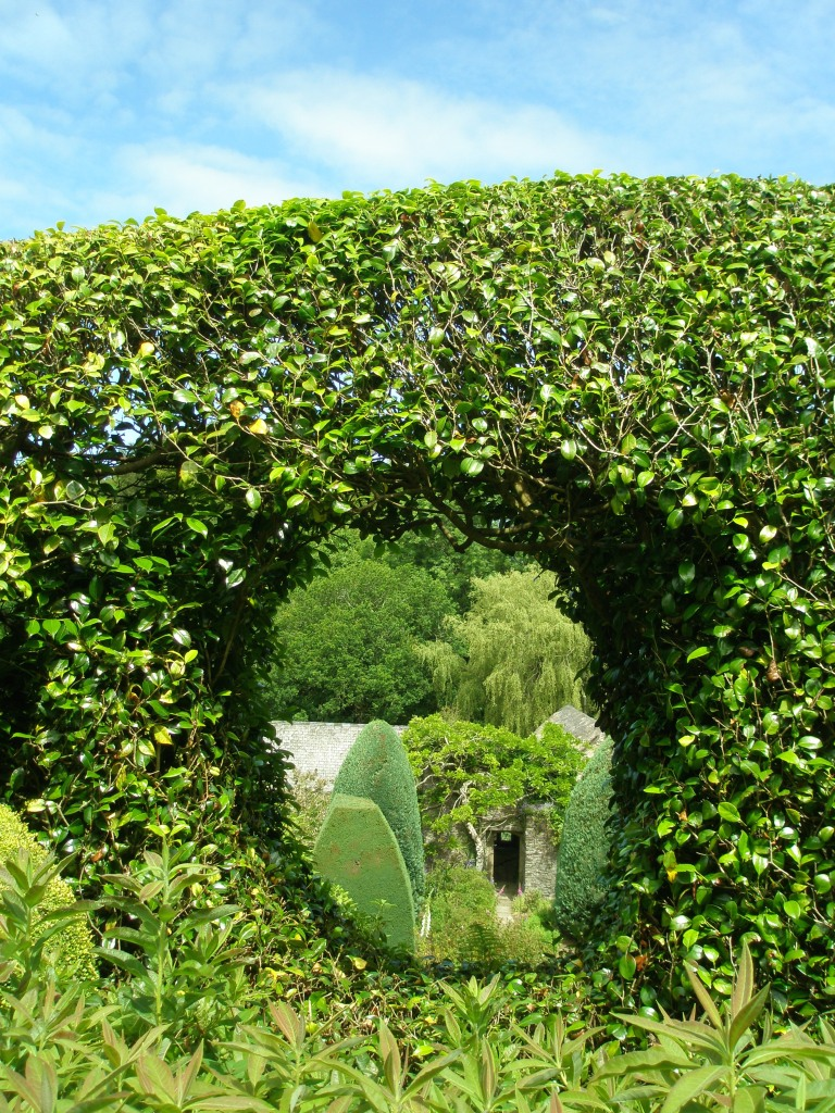 A Moon Window has been carved through the high hedge which separates the House from the Bowling Green Terrace