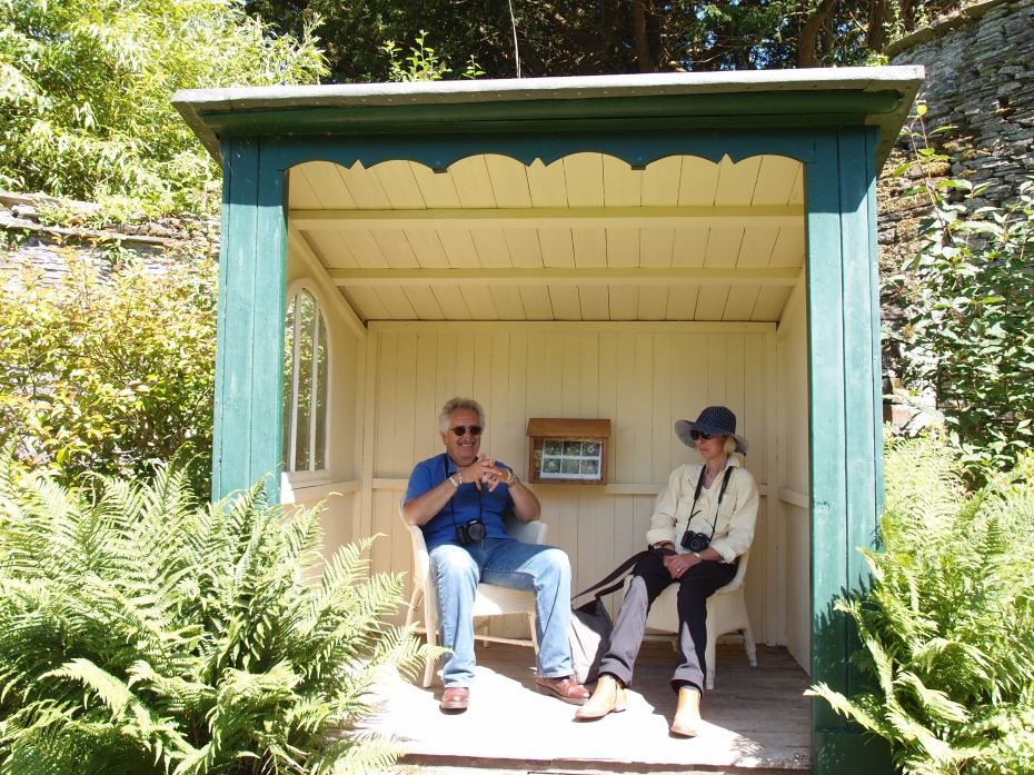 David and Anne rest their feet, in a Wild Garden Shelter