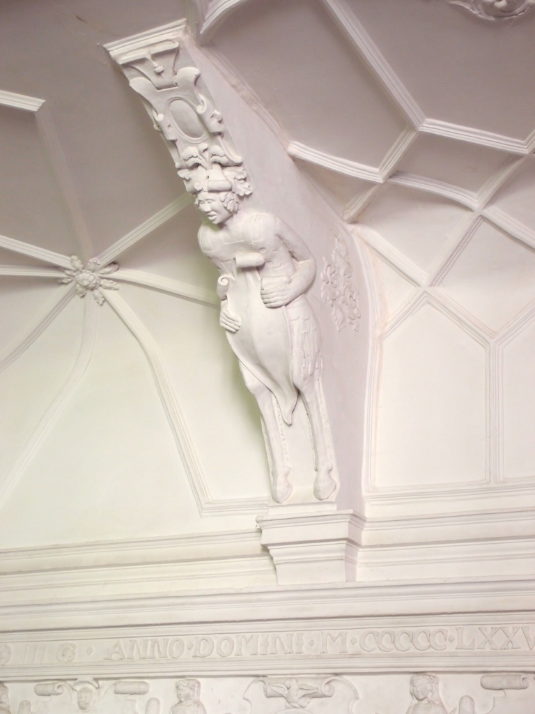 The Great Hall's ceiling is supported by shield-bearing satyrs.