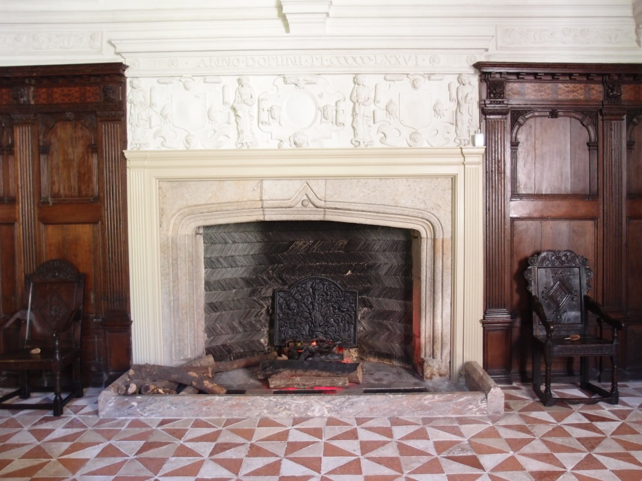 The Great Hall's granite fireplace, with herringbone pattern of slate at the back, is typical of the 16th century.