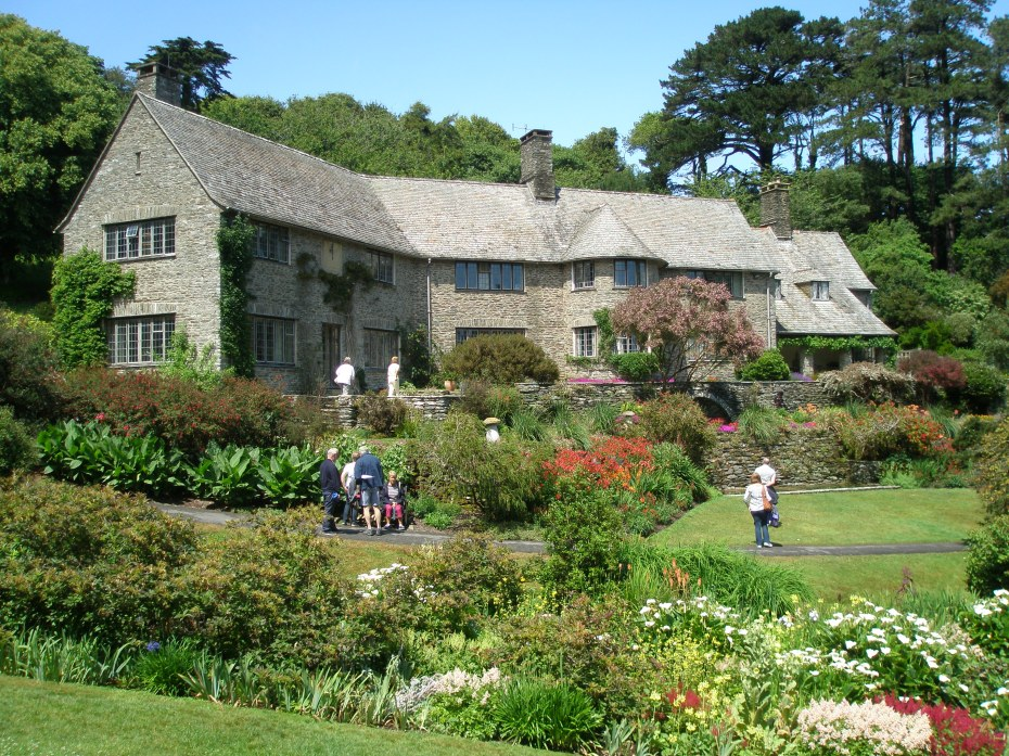 At Coleton Fishacre, by Pudcombe Cove, on the South Devon coast, we see a perfect, harmonious interplay of architecture and gardens and the greater landscape. The country retreat of Rupert and Lady Dorothy D'Oyly Carte began to be created in 1923. Rupert, the son of impresario Richard D'Oyly Carte, was the manager of the hugely popular—and profitable—Gilbert & Sullivan empire of operettas, as well as the owner of the Savoy Hotel and Claridge's, in London. The Arts and Crafts-styled stone house and terraces were constructed largely from Dartmouth shale, which was quarried on site. On July 2nd, 2015, after a morning of dense fog and driving rain, the skies cleared, and Coleton Fishacre, which during the first hours of my visit had seemed to be a spooky Daphne-DuMaurier-setting-made-real, was transformed into the glistening, cheer-inducing, jewel-by-the-sea that you see here, and which we will explore at length, in the final portion of this Travel Diary.