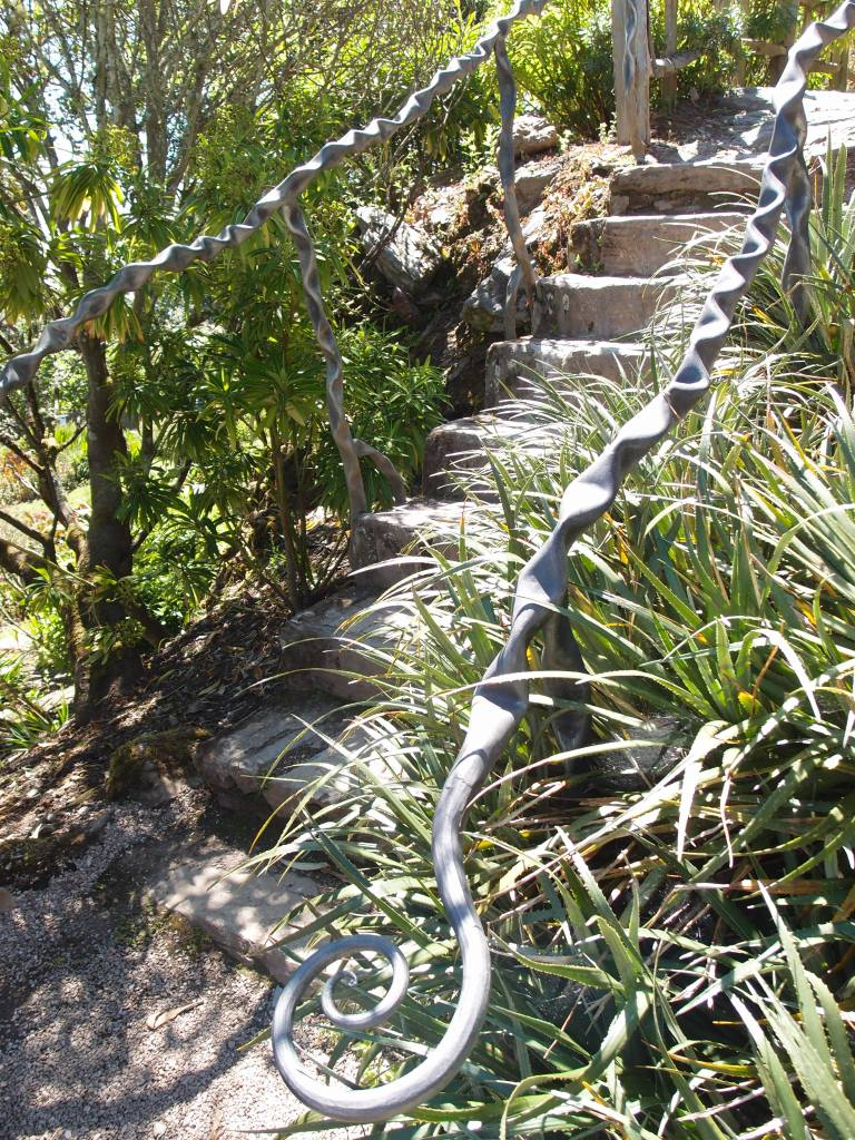 A flight of stairs in the Rock Dell leads up, toward the Olive Grove & Picnic Area.