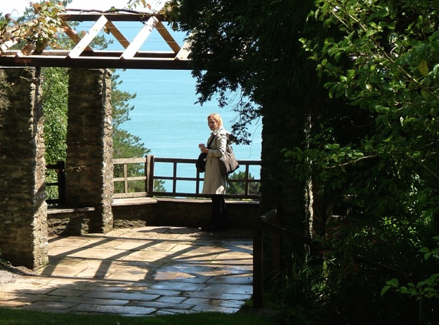Nan...doing a bit of sun-basking, in the Gazebo. The hexagonal Gazebo, with stone pillars and a wooden trellis to support wisteria, offers a spectacular ocean view. When it was first built, the Gazebo also had a clear view inland, back to the House. Photo by Anne Guy.
