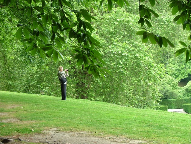This is what touring a garden with me looks like: I'm wandering, alone, as I take in my surroundings and then frame the views with my camera. As I took the picture you've just seen, Anne photographed me.
