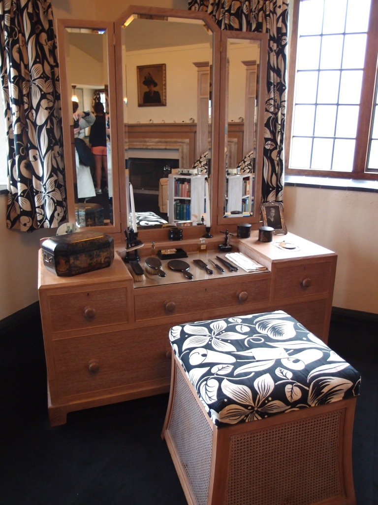 Lady Dorothy's dressing table (reproduction) and stool (original). The upholstered stool is the Very One upon which Dorothy sat, and is covered with new yardage of the same black and white fabric (style: Les Arums, designed by Raoul Dufy) that was first used, throughout this bedroom.