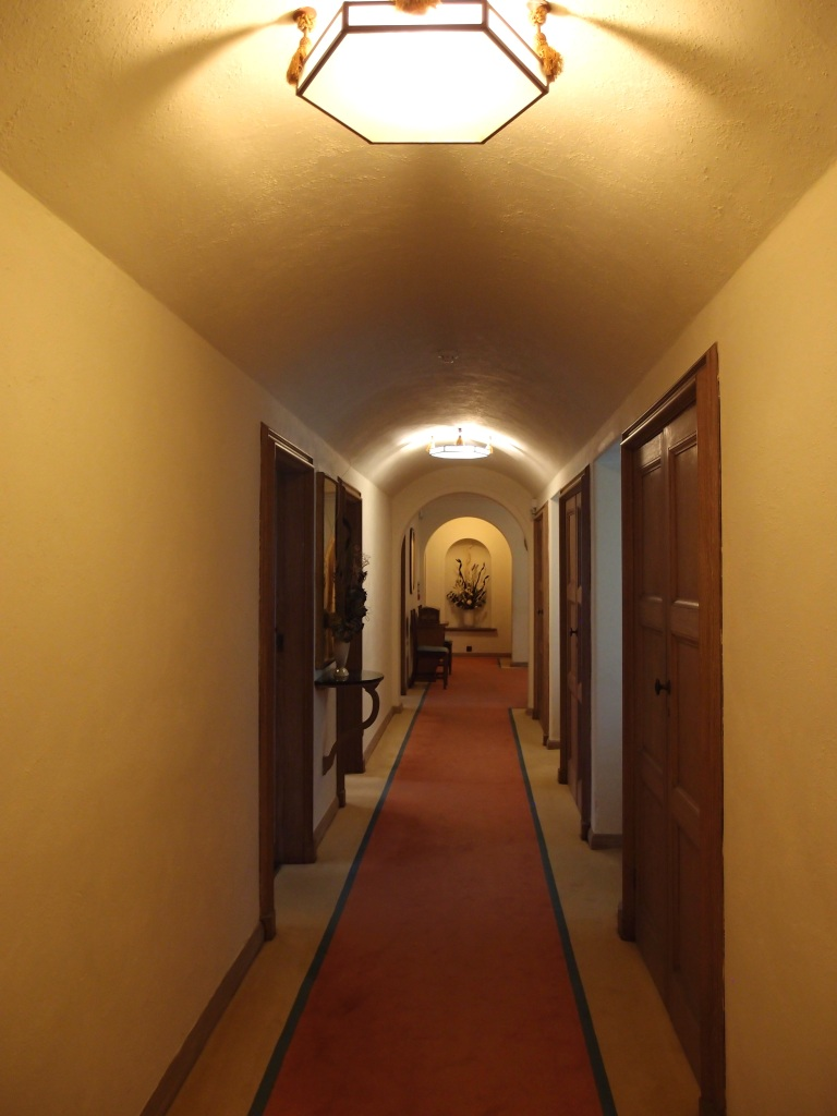 Bedroom Corridor. The ceiling light is original to the House. Note: the entrance to Lady Dorothy's bedroom is at the far end of the hall.