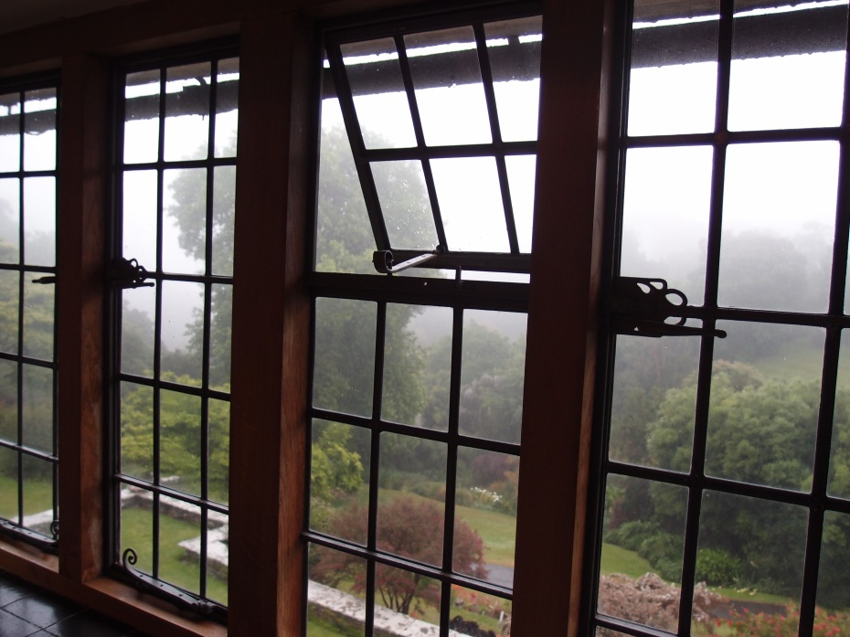 View from the East Bedroom…trust me, despite the blanket of fog outside in this photo, you WILL soon see the gardens. Throughout the house, all of its mullioned windows have ironwork fittings, and are set above black Staffordshire tile sills.