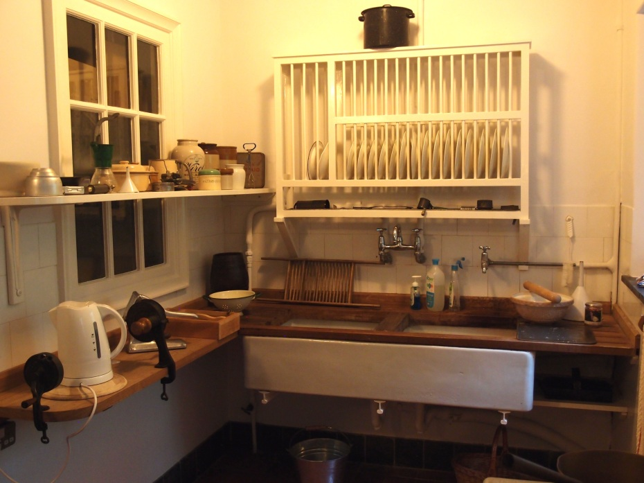 The Kitchen's double Belfast sink, and the plate rack above it, are original to the house.