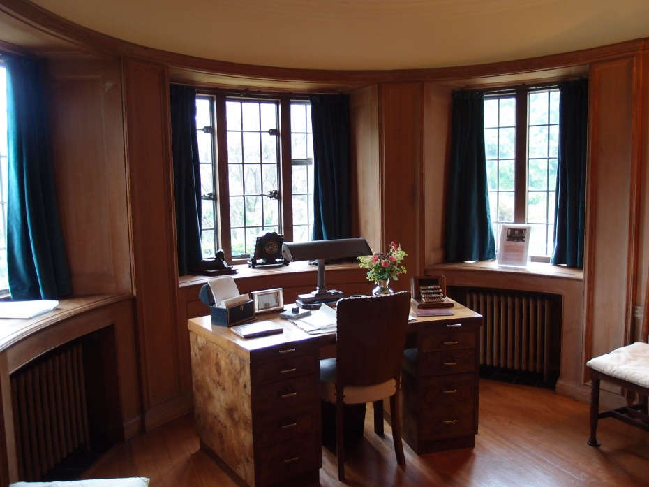 Rupert's desk occupied the prime spot in the Library.