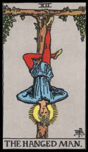 "The Hanged Man, Card XII of the Tarot. Niki placed the Hanged Man inside of her Tree of Life. Per Niki: ""The Hanged Man has fascinated poets and artists throughout the ages. The Hanged Man is suspended by his foot. He is in the position to view the world upside down, thus in a new way. The card also represents Compassion."""
