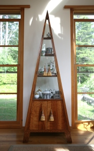 My Pyramidal Vitrine was built by Neil Ritter. I chose silk curtain tassels to use for the door-pulls.