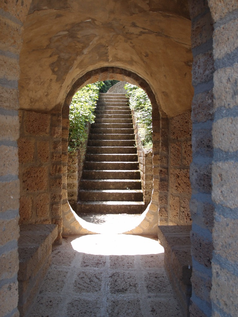 A beautifully-formed passage through the base of the Ruined Column. The stairs lead uphill, to a portion of the Ideal City which we must still visit.