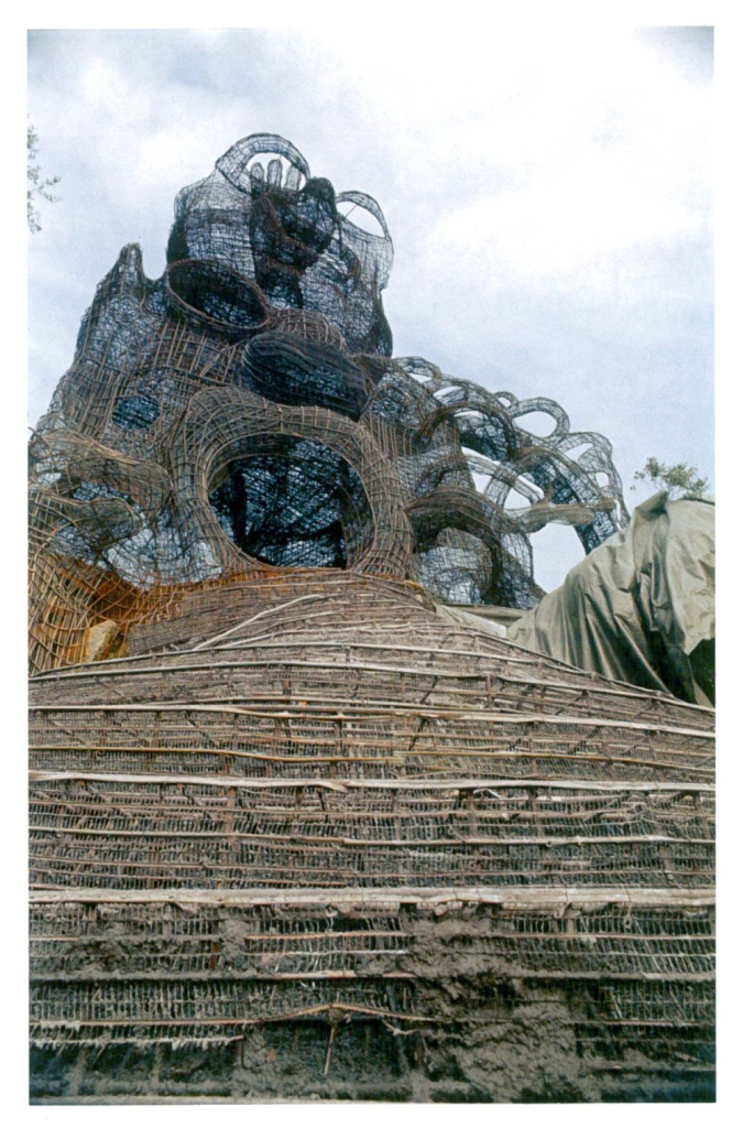 The High Priestess, with The Magician atop her, under construction, in 1982. All rebar has now been placed, and cement will soon cover the entire structure. Image courtesy of Il Fondazione Giardino Dei Tarocchi.