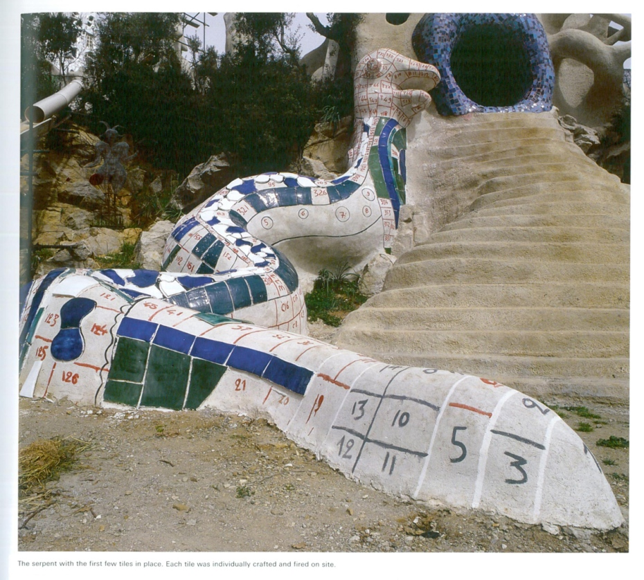 Detail of Serpent by the waterfall of the High Priestess, under construction. The first tiles have been affixed. Each tile was individually crafted and fired on site. Image courtesy of Il Fondazione Giardino Dei Tarocchi.